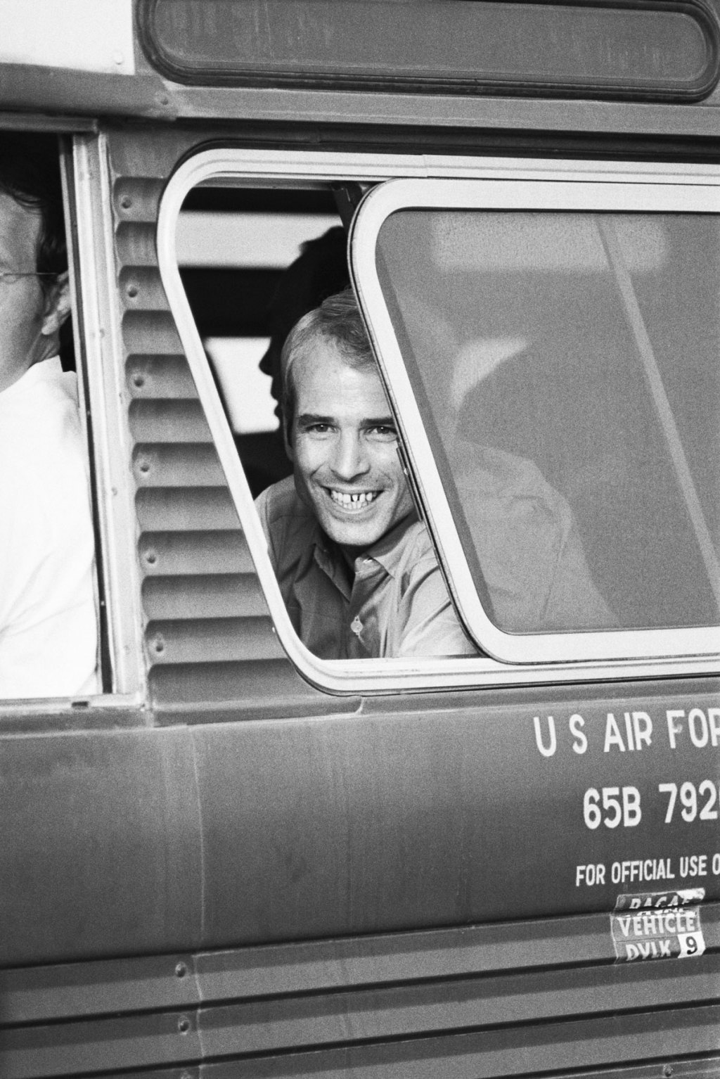 American prisoner of war, Navy Lt. Commander John McCain III, smiles from a bus window on arrival at Clark Air Base in the Philippines, after his release from Hanoi during the Vietnam War on March 14th, 1973. McCain was taken prisoner on 26th October 1967. He is the son of retired Admiral John S. McCain Jr., whose last post was Commander-in-Chief of the Pacific Forces.