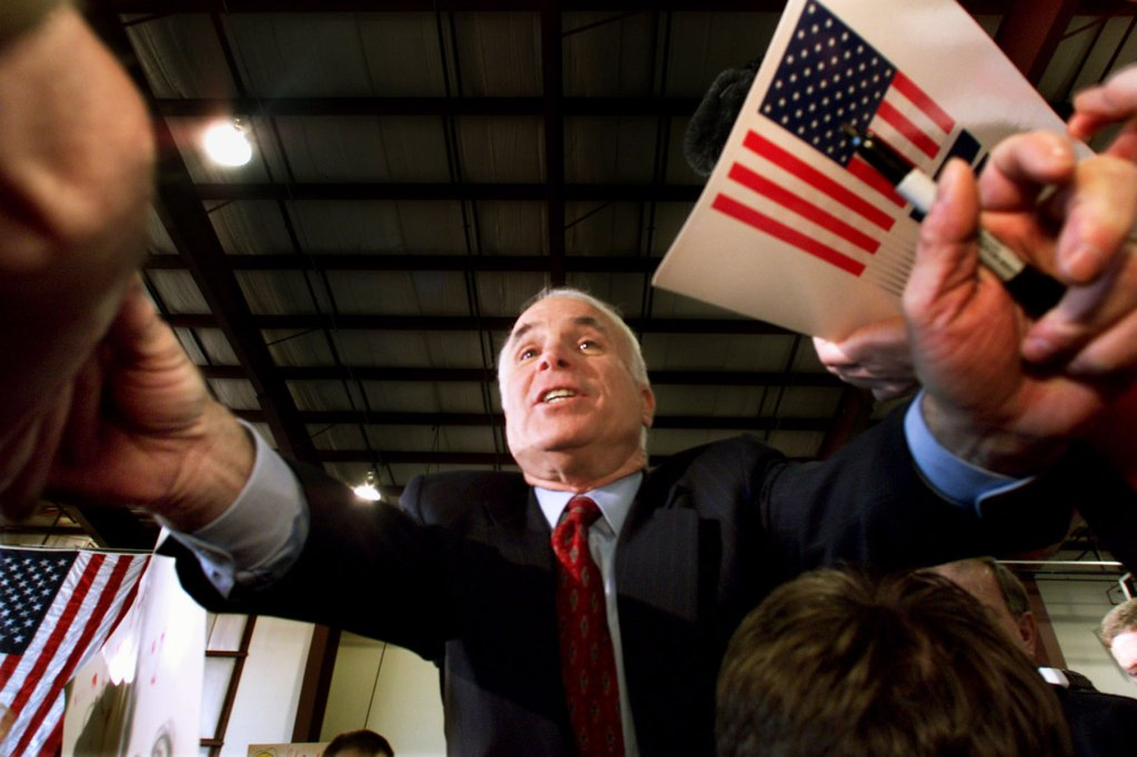 Senator John McCain reaches out to supporters at a campaign rally in Portland, Maine on Saturday, March 4, 2000. He will go on from Maine back to the state of New York.