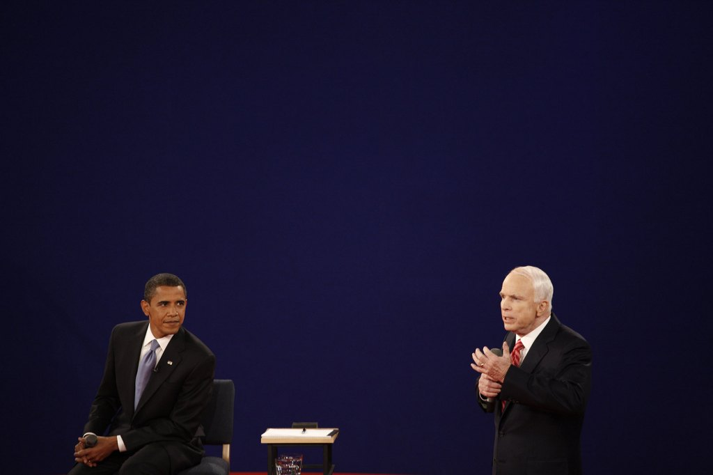 Republican presidential candidate Sen. John McCain and Democratic presidential candidate Sen. Barack Obama take part in the debate moderated by Tom Brokaw (C) at Town Hall Presidential Debate at Belmont University's Curb Event Center October 7, 2008 in Nashville, Tennessee.