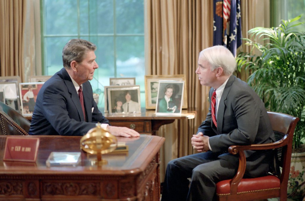 President Ronald Reagan meets with Senator John McCain in the White House's Oval Office, Washington D.C., on July 31, 1986.