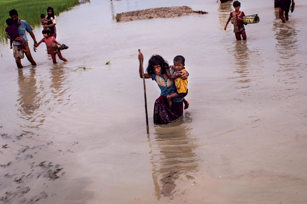 There are nearly 40,000 unaccompanied children living in the camps, where relief workers say the conditions are dismal, with disease rampant and access to food and water strained. Now, the summer monsoon season brings the threat of flooding. Photo: Patrick Brown/Panos Pictures/UNICEF
