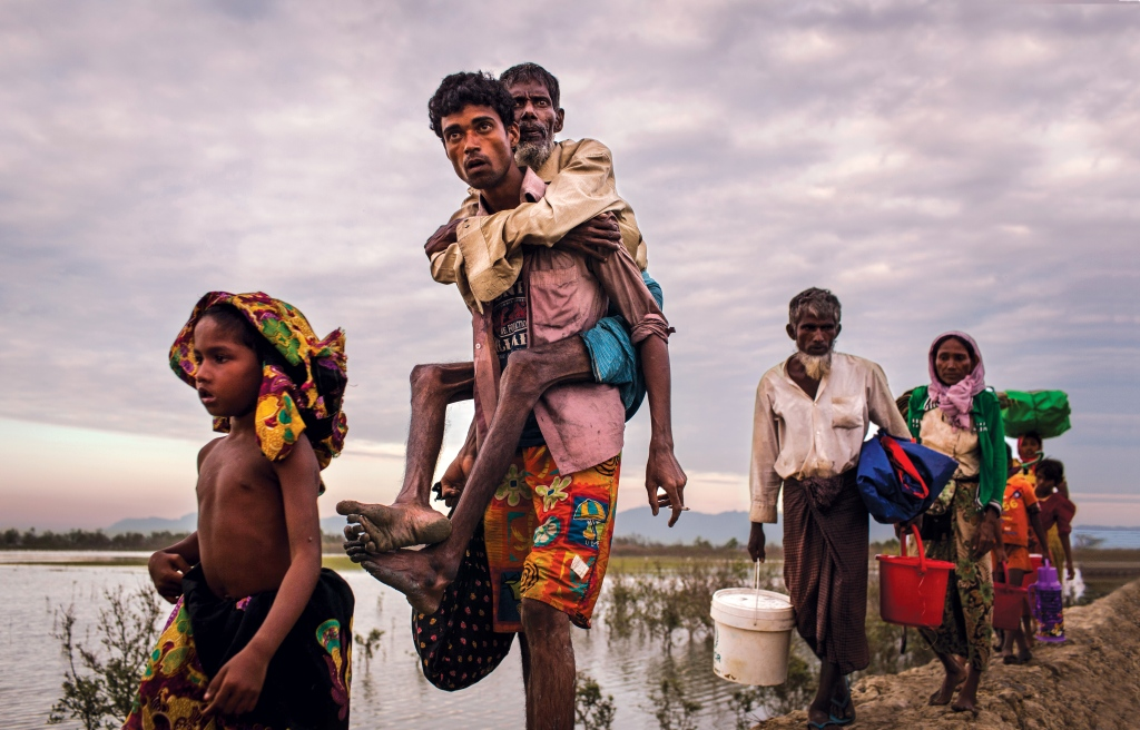 A family of Rohingya Muslims flee Myanmar after a wave of violence last fall. Photo: Patrick Brown/Panos Pictures/UNICEF