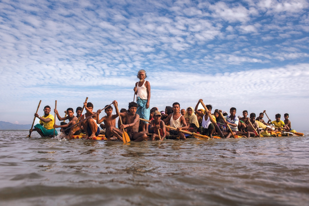 Rohingya fleeing across the Naf River to Bangladesh. The crisis made global headlines in 2015 when boats packed with starving Rohingya were stranded at sea. For weeks, no country would accept them. Photo: Patrick Brown/Panos Pictures/UNICEF