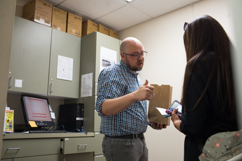 ANCHORAGE, ALASKA --Tuesday, July 31, 2018: Matt Allen, the HIV prevention and education director at Four A's, talks with a participant at the needle exchange./ASH ADAMS
