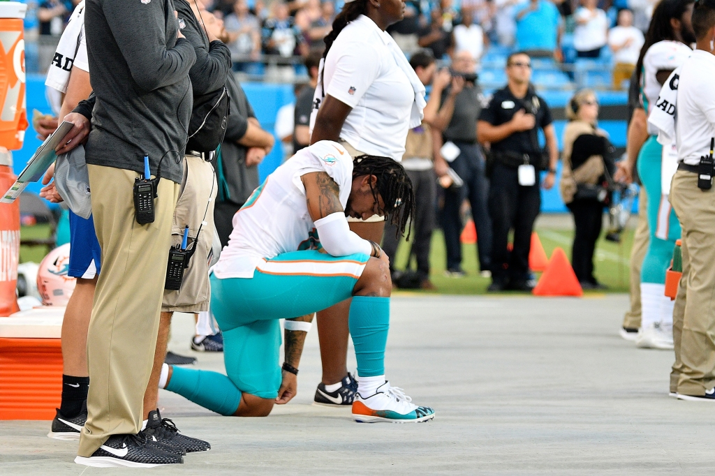 CHARLOTTE, NC - AUGUST 17: Albert Wilson #15 of the Miami Dolphins kneels during the anthem before their game against the Carolina Panthers at Bank of America Stadium on August 17, 2018 in Charlotte, North Carolina. (Photo by Grant Halverson/Getty Images)
