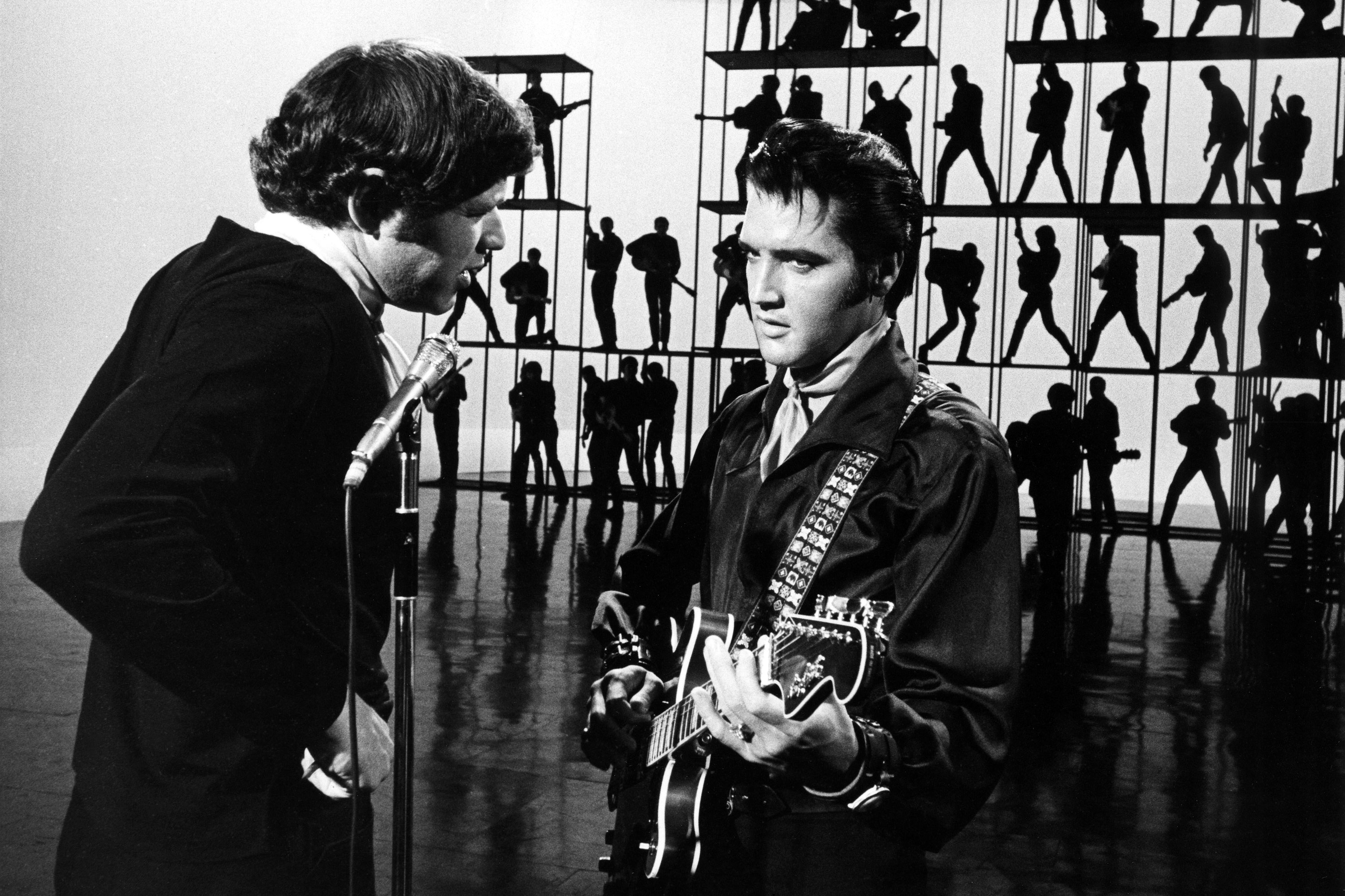 65deafe01422 Director Steve Binder speaks with Elvis Presley during his 1968 Comeback  Special. Frank Carroll Gary Null NBC NBCU Photo Bank Getty Images
