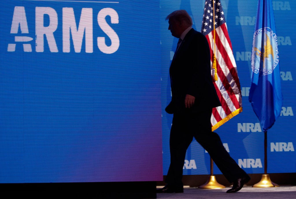 President Donald Trump leaves the stage after addressing the National Rifle Association convention in Dallas, May 4, 2018. Trump began his remarks by hailing a number of Republican politicians in attendance, voicing full support for Sen. Ted Cruz in his bid for re-election. (Tom Brenner/The New York Times)