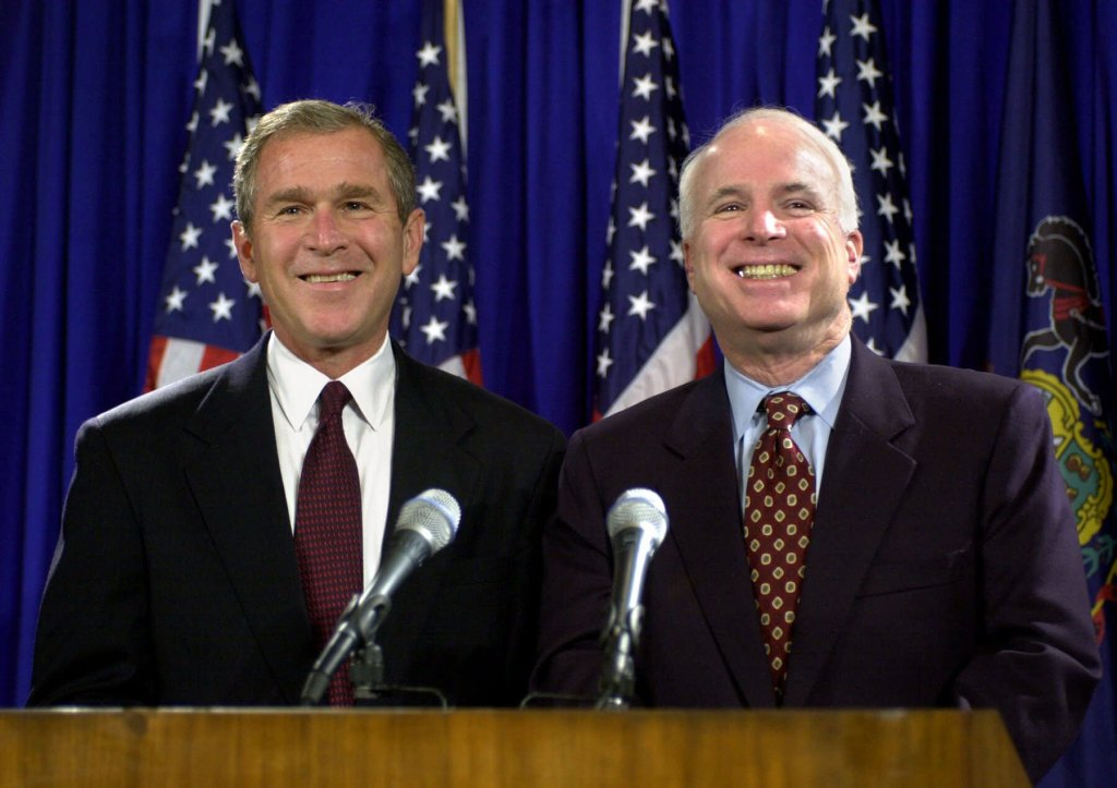 """Republican presidential candidate Texas Gov. George W. Bush and Arizona Sen. John McCain react to a questions from reporters during a news conference after their meeting in Pittsburgh, PA, . Setting aside their bitter primary battle, McCain endorsed George W. Bush Tuesday and said he looked forward to """"enthusiastically campaigning"""" for the likely Republican presidential nominee. McCain, however, asked not to be considered as a running mate"""