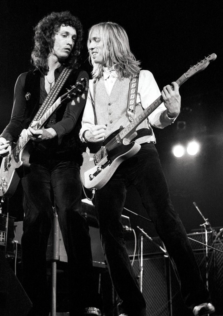 LONDON - MAY 14: Mike Campbell (left) and Tom Petty from Tom Petty & The Heartbreakers perform live on stage at the Hammersmith Odeon before their concert on May 14 1977 (Photo by Ian Dickson/Redferns)