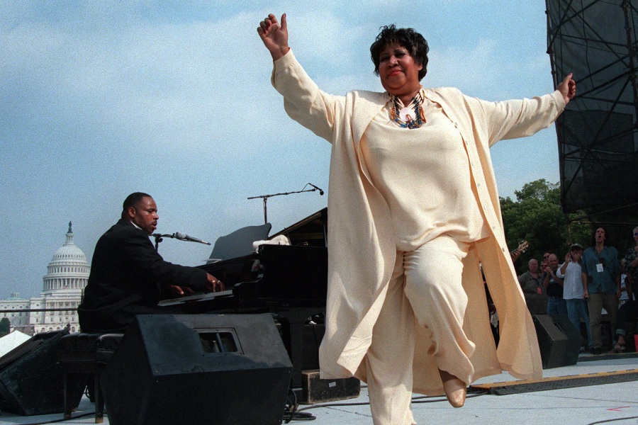 FRANKLIN Singer Aretha Franklin dances on stage during the first annual march on cancer, in Washington. The daylong event, known as ''The March,'' drew thousands of cancer survivors, patients, and loved ones descending on the National Mall to remember cancer victims and to ask for more research fundsCANCER MARCH, WASHINGTON, USA