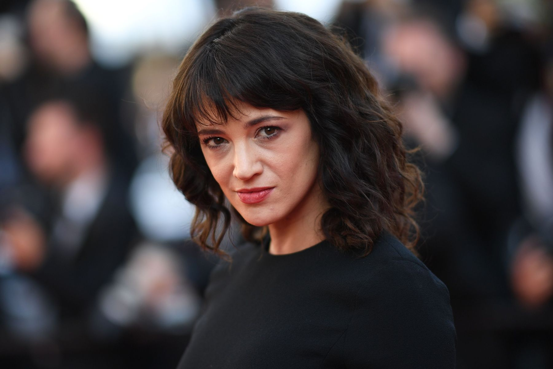 "Italian actress Asia Argento poses as she arrives on May 19, 2018 for the closing ceremony and the screening of the film ""The Man Who Killed Don Quixote"" at the 71st edition of the Cannes Film Festival in Cannes, southern France. (Photo by Loic VENANCE / AFP)        (Photo credit should read LOIC VENANCE/AFP/Getty Images)"