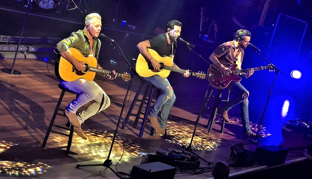 """The members of Old Dominion stripped down a portion of their set, taking to stools for a mainly acoustic performance of """"Stars in the City"""" and """"Still Writing Songs About You."""""""