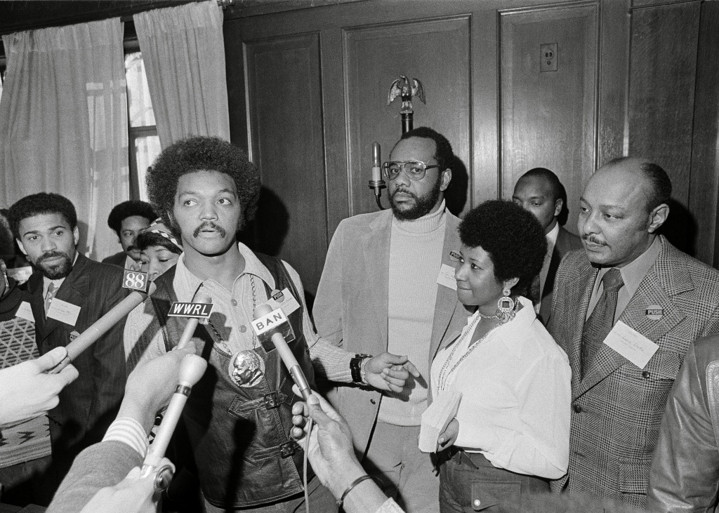 Jesse Jackson, Betty Shabazz, Tom Todd, Aretha Franklin, Louis Stokes Rev. Jesse Jackson speaks to reporters at the Operation PUSH Soul Picnic at the 142nd Street Armory in New York, . Left to right are: Betty Shabazz, behind Jackson, widow of Malcolm X; Jackson; Tom Todd, vice president of PUSH; Aretha Franklin and Louis Stokes. PUSH stands for People United to Save HumanityOperation PUSH Soul Picnic 1972, New York, USA