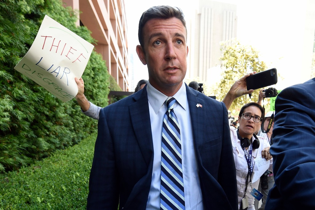 U.S. Rep. Duncan Hunter, center, leaves an arraignment hearing, in San Diego. Hunter and his wife Margaret pleaded not guilty Thursday to charges they illegally used his campaign account for personal expensesIndicted California Congressman, San Diego, USA - 23 Aug 2018