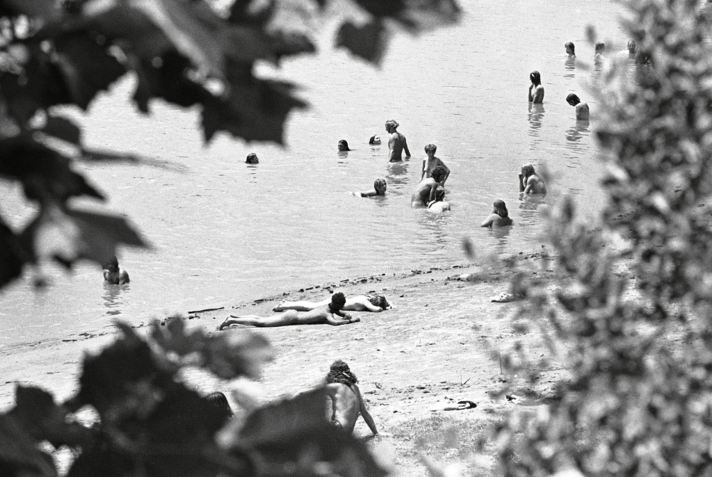 "Nude men and women sun on the beach and frolic in the waters of the Atchafalaya River as they wait for a court delayed ""Celebration of Life"" festival to open, at McCrea, LaCelebration of Life Festival, McCrea, USA"