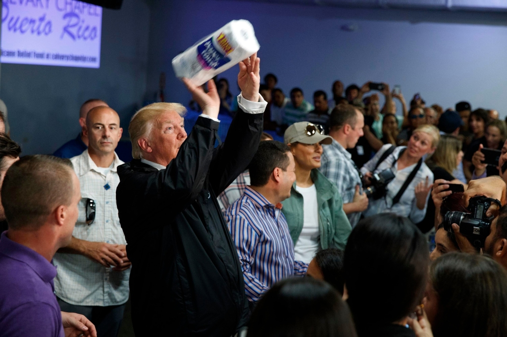 President Donald Trump tosses paper towels into a crowd as he hands out supplies at Calvary Chapel, in Guaynabo, Puerto Rico. Trump is in Puerto Rico to survey hurricane damageTrump, Guaynabo, Puerto Rico - 03 Oct 2017