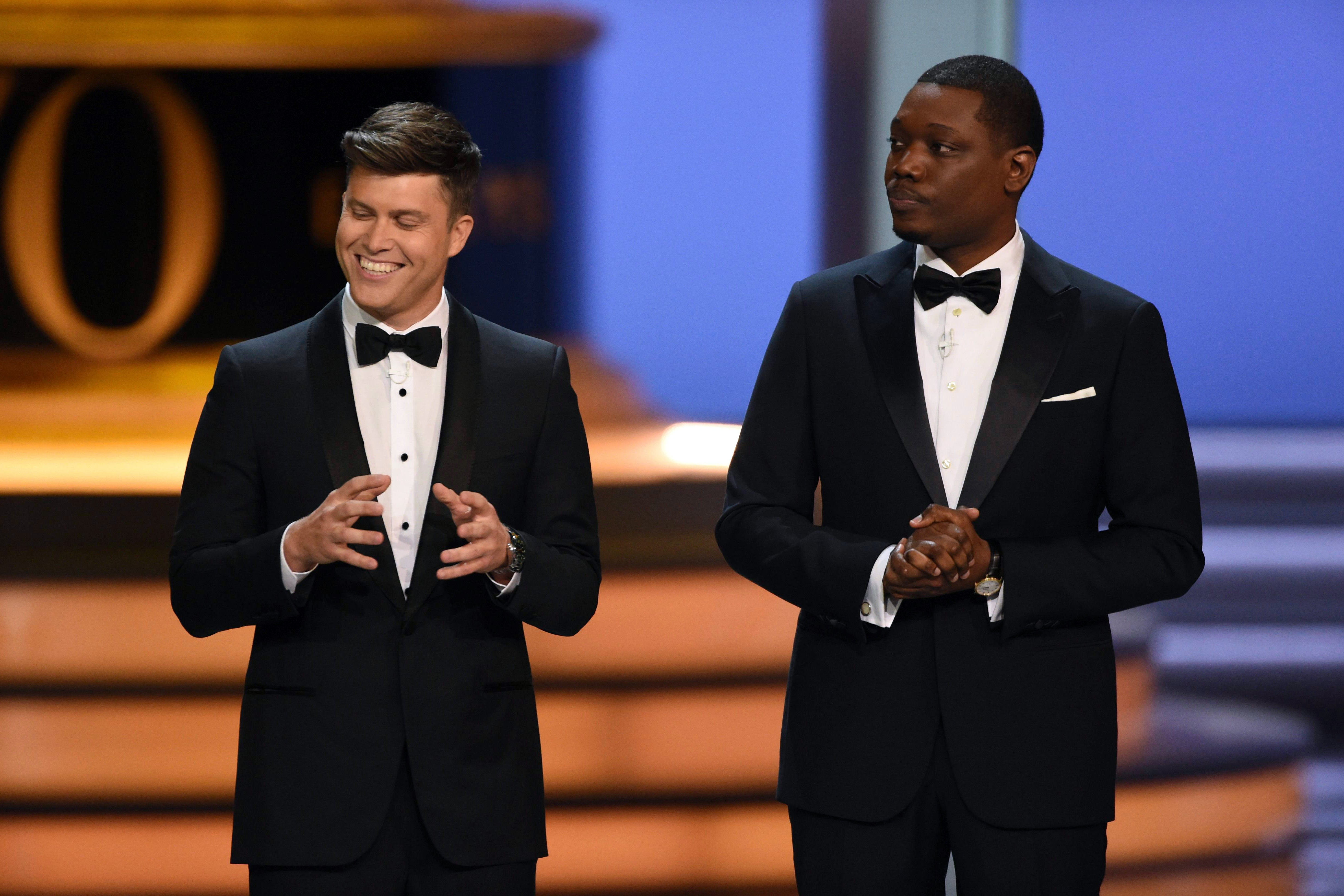 Hosts Colin Jost, Michael Che. Hosts Colin Jost, left, and Michael Che speak at the 70th Primetime Emmy Awards, at the Microsoft Theater in Los Angeles70th Primetime Emmy Awards - Show, Los Angeles, USA - 17 Sep 2018
