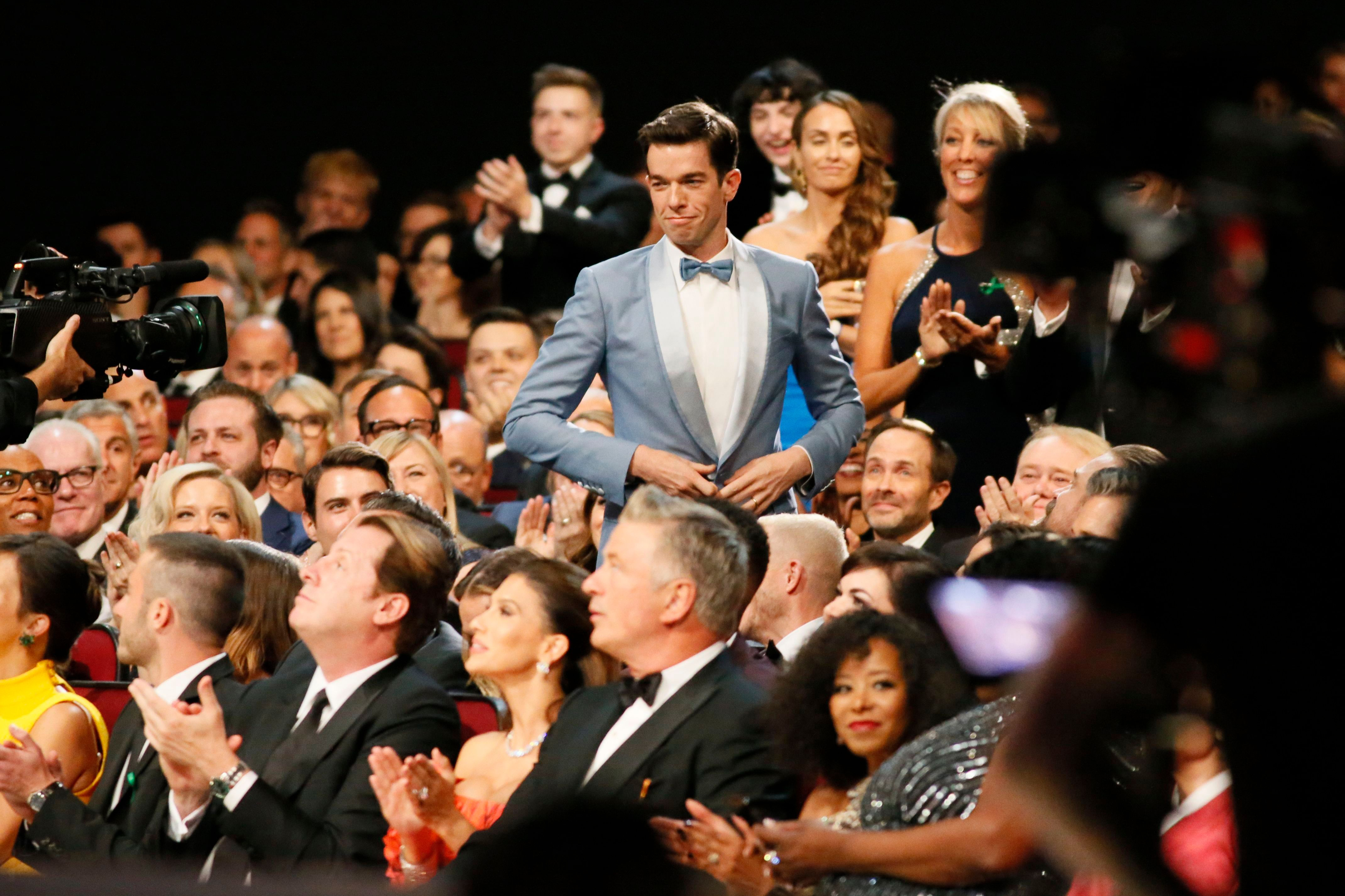 John Mulaney stands up to accept the award for outstanding writing for a variety special70th Primetime Emmy Awards - Audience, Los Angeles, USA - 17 Sep 2018