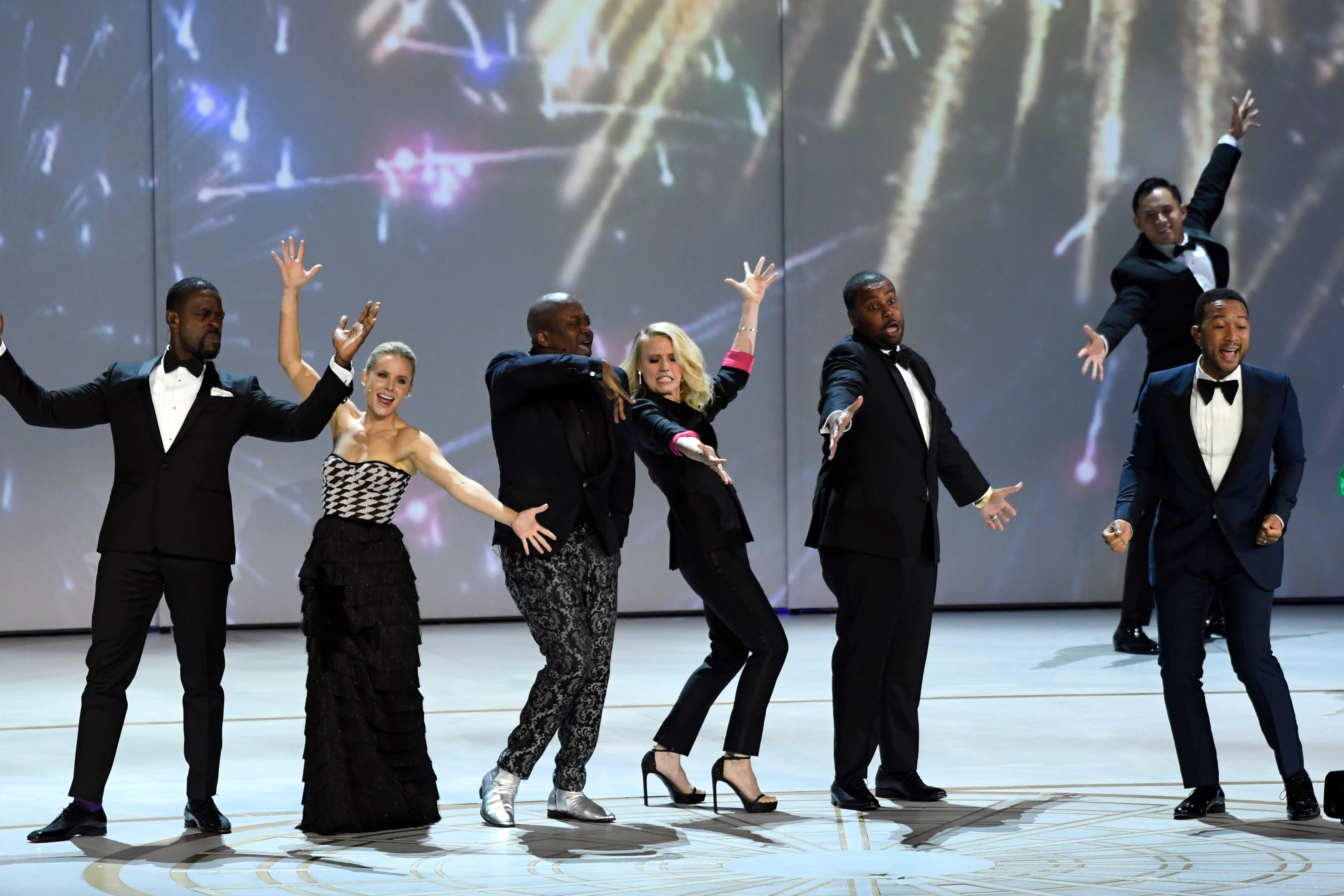 Sterling K. Brown, Kristen Bell, Tituss Burgess, Kate McKinnon, Kenan Thompson, John Legend. Sterling K. Brown, from left, Kristen Bell, Tituss Burgess, Kate McKinnon, Kenan Thompson, and John Legend perform on stage at the 70th Primetime Emmy Awards, at the Microsoft Theater in Los Angeles2018 Primetime Emmy Awards - Show, Los Angeles, USA - 17 Sep 2018