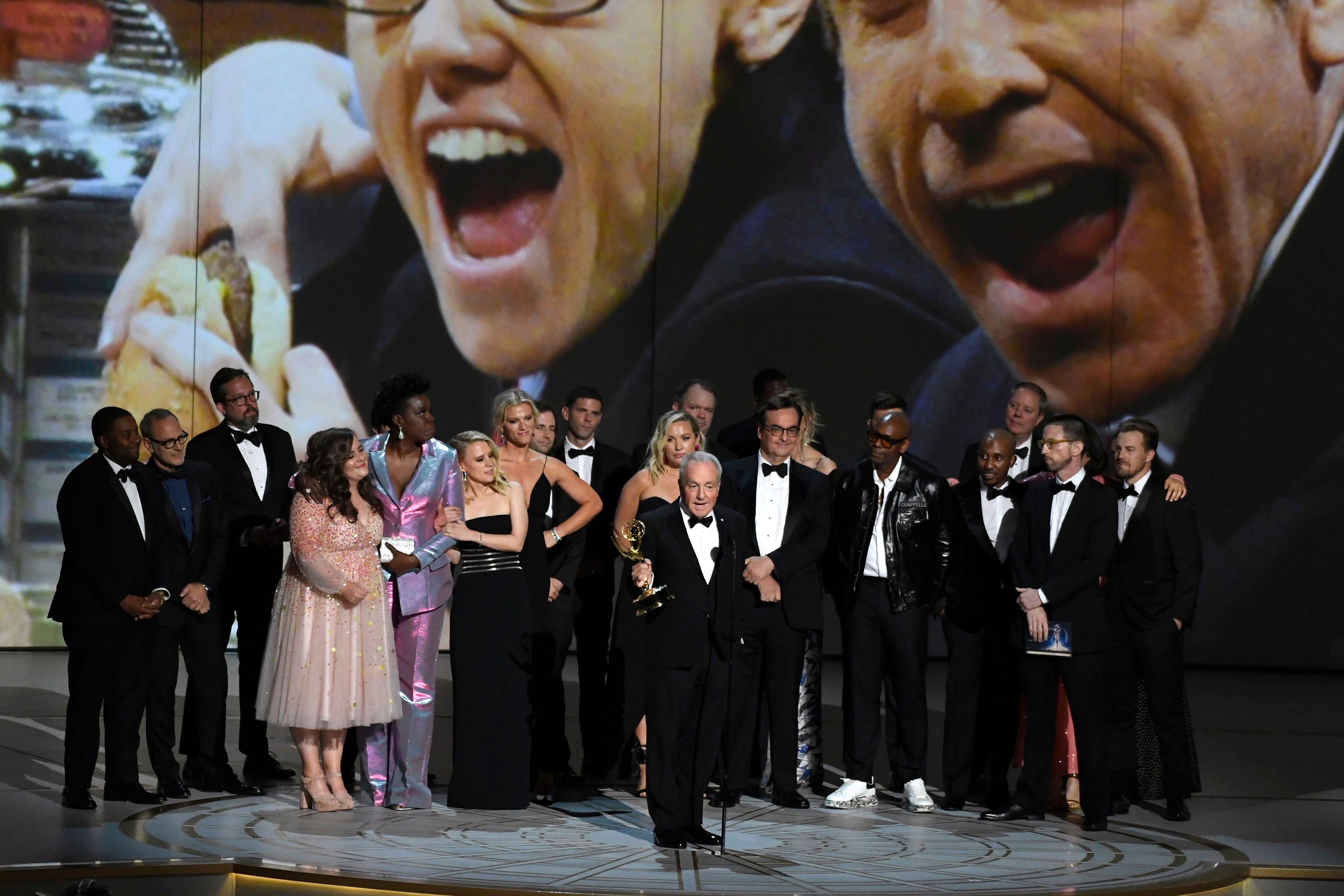 """Lorne Michaels, center, and the cast and crew from """"Saturday Night Live"""" accept the award for outstanding variety sketch series at the 70th Primetime Emmy Awards, at the Microsoft Theater in Los Angeles2018 Primetime Emmy Awards - Show, Los Angeles, USA - 17 Sep 2018"""