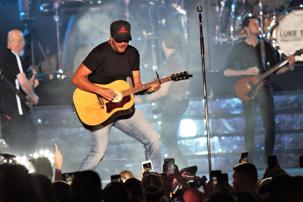 Luke Bryan rocks out at his massive street concert, which included appearances by Cole Swindell and Ryan Hurd.