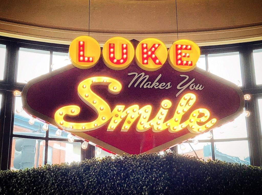 """Luke makes you smile,"" reads one sign at Luke Bryan's new 32 Bridge bar."