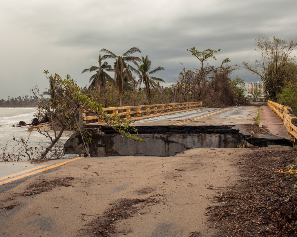 Toa Baja, Puerto Rico - 10/6/17: A road linking Toa Baja and Levittown that collapsed. during the storm. Hurricane MarÌa slammed into the island of Puerto Rico, a U.S. territory, on September 20, 2017 as a high-end category 4 storm. The damage has left 40% of the island without drinking water and 95% of the island without electricity. The official death toll was of 34 as of October but secondary deaths are estimated in the hundreds. The town of Toa Baja saw flooding of up to 13 feet in some areas and was the sight of some of the most harrowing rescues and the first registered deaths. Situated in a flood plane flaked by former sugar cane fields on either side the water remained in the communities for a couple of days. CREDIT: Christopher Gregory for The New Yorker