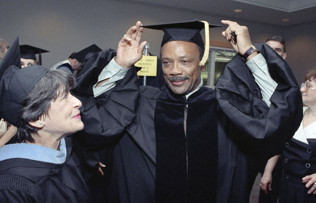 Quincy Jones, a founding member of the Institute for Black American Music and winner of Five Grammy Awards, adjusts his cap on at Brandeis University in Waltham, Mass., before the university started its 41st commencement exercises where he received a Doctor of Music degree in 1992.