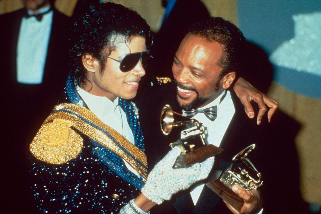 Quincy Jones and Michael Jackson with their awards after the 1984 Grammy Awards.