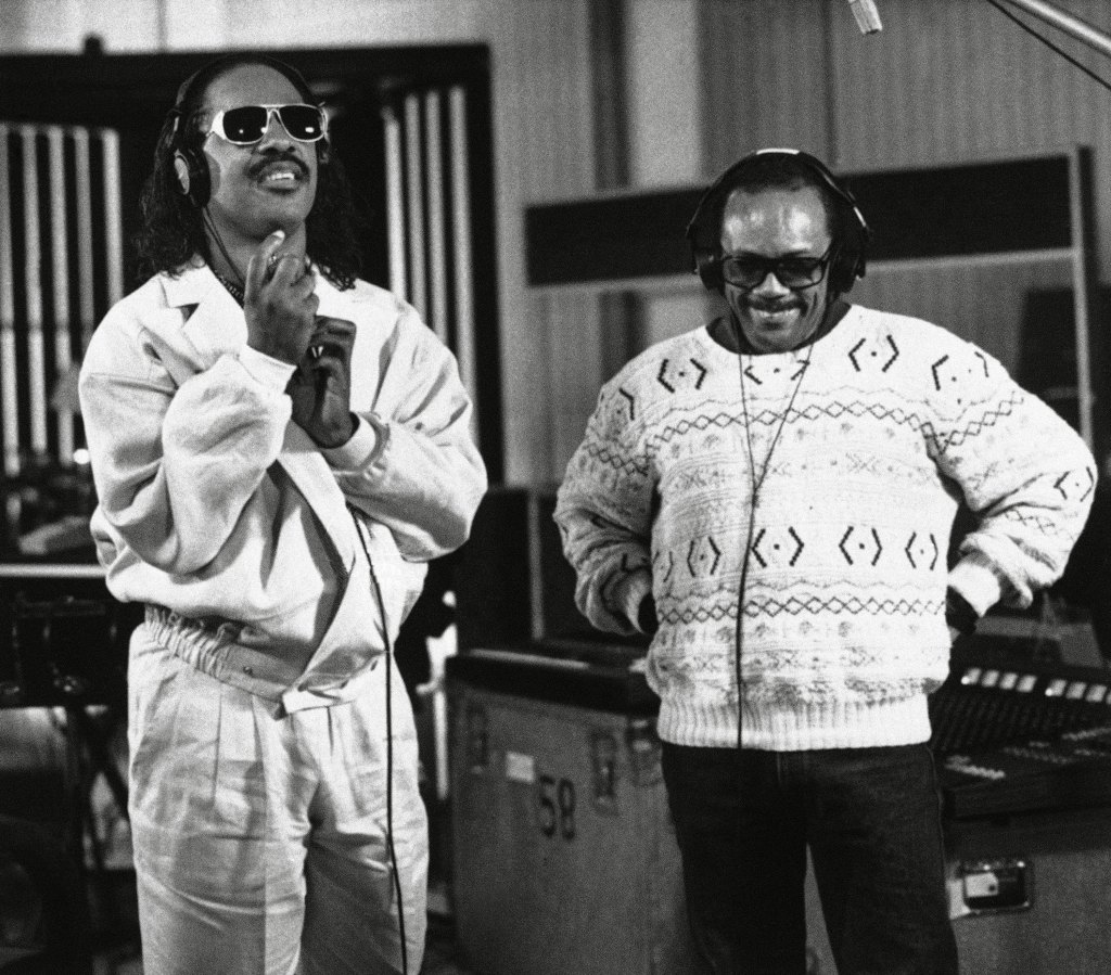 Stevie Wonder, left, and Quincy Jones participate in a coast-to-coast recording session, linked to a studio in New York, to record an anti-drug song, in Los Angeles in 1987.