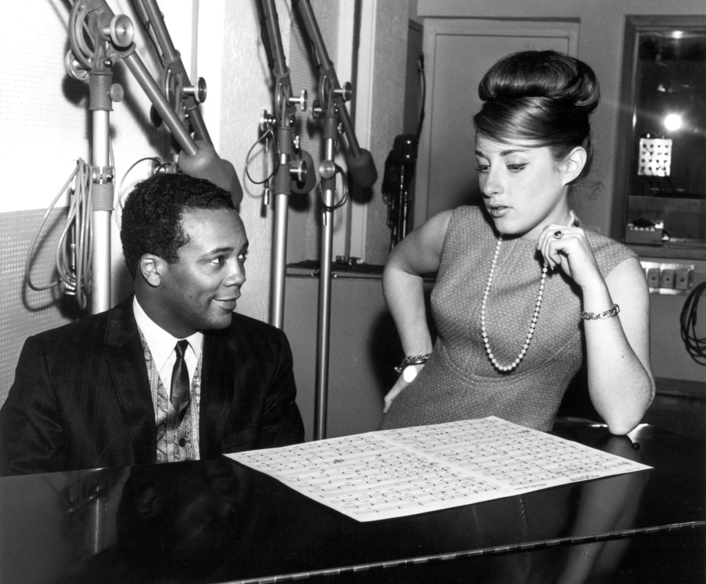 "Producer Quincy Jones and singer Lesley Gore work on ""It's My Party"" in circa 1956 in New York, New York. (Photo by PoPsie Randolph/Michael Ochs Archives/Getty Images)"