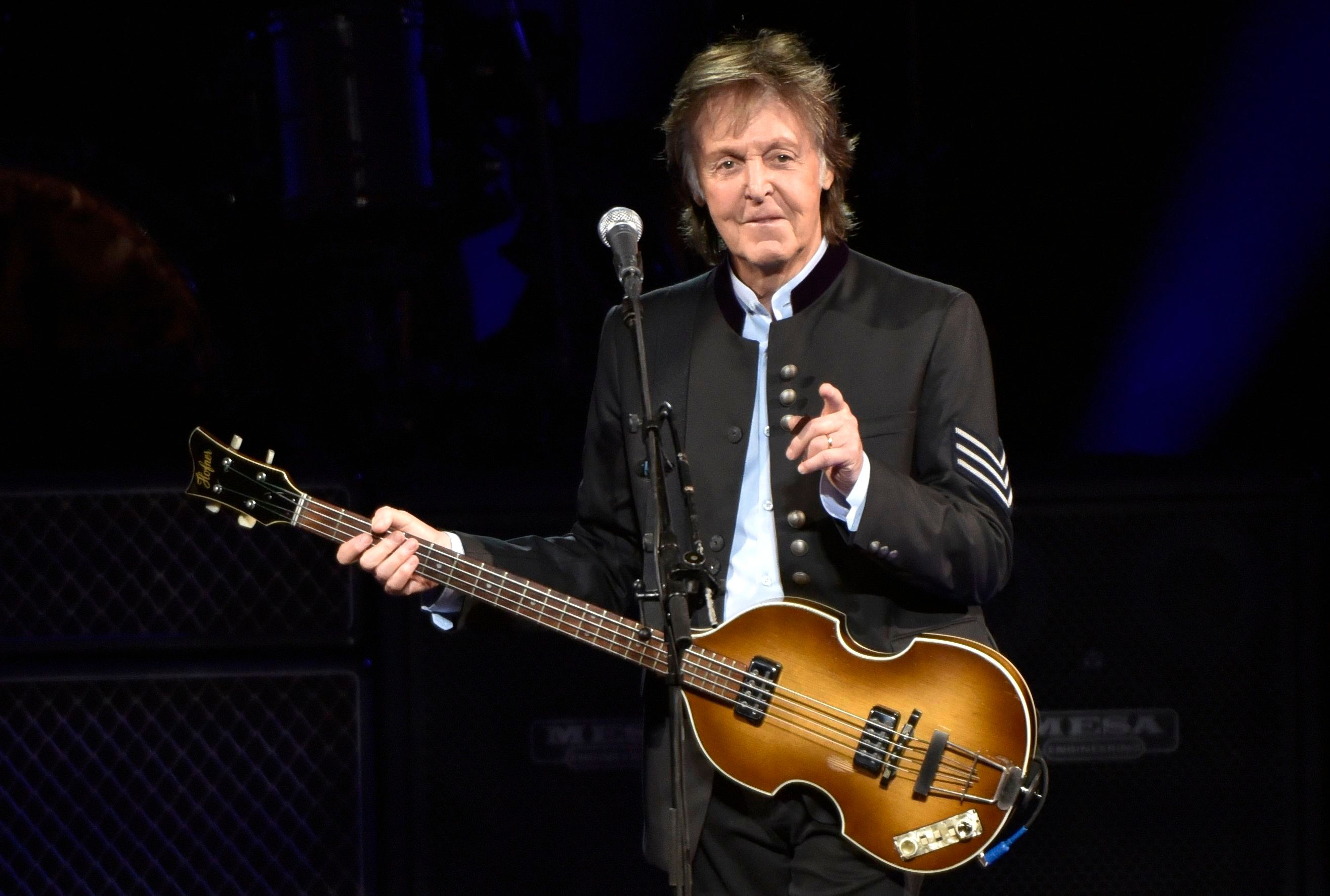 """Paul McCartney performs on the One on One Tour at the Hollywood Casino Amphitheatre in Tinley Park, Ill. It was a magical mystery tour as McCartney led James Corden through his hometown during a """"Carpool Karaoke"""" segment on CBS' """"Late Late Show."""" The program, wrapped up a weeklong stay in London and the Beatles legend joined Corden for a drive around LiverpoolPaul McCartney Carpool Karaoke, Tinley Park, USA - 27 Jul 2017"""