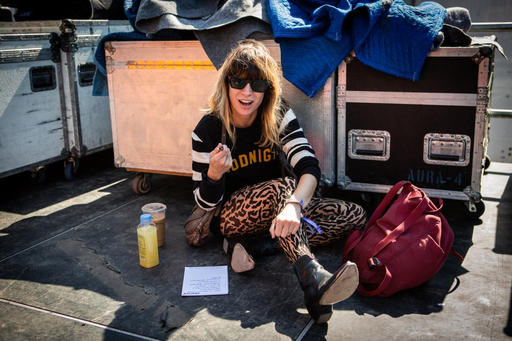 Nicole Atkins takes time before she hits the stage to write out her set list.