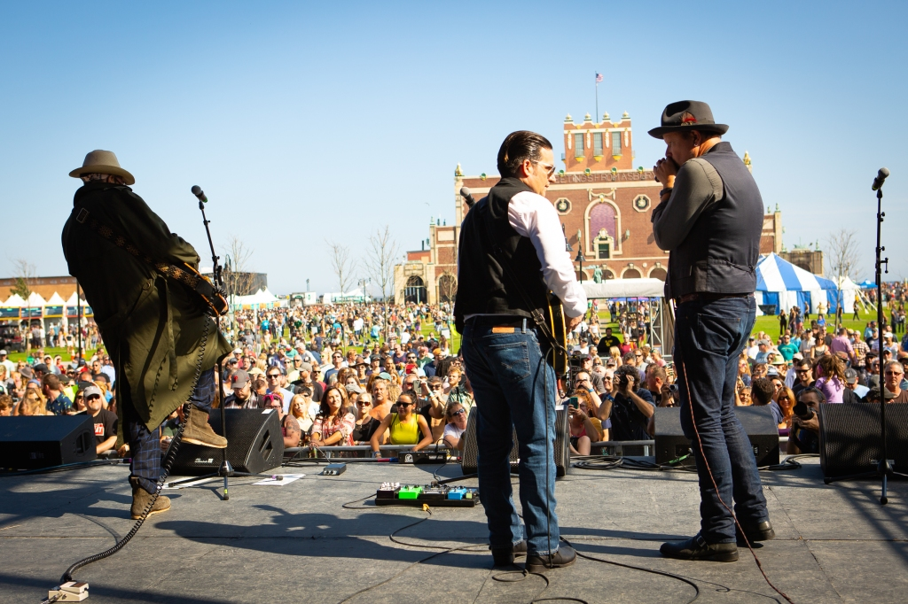 Danny Clinch and Chris Scianni trade licks on the Park Stage with Convention Hall looming in the background.
