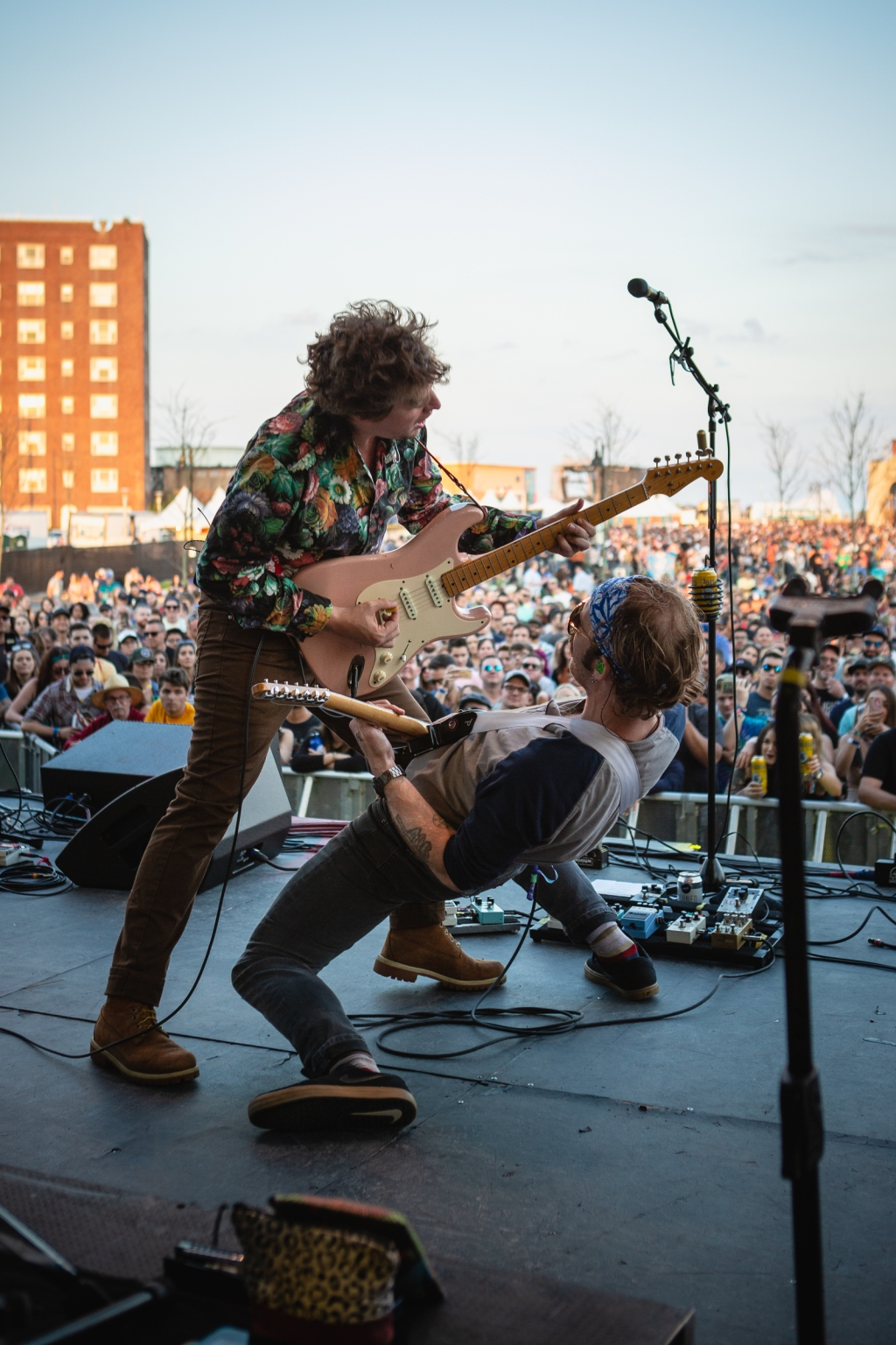 Ian O'neil and John McCauley of Deer Tick get low on the Park Stage.