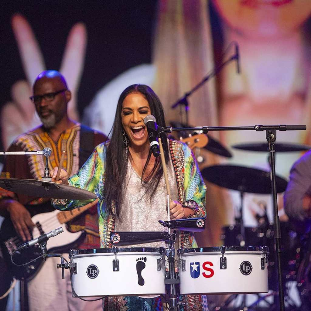 "Sheila E. turned El Dorado into Erotic City. The legendary drummer's festival-opening set saw her strutting down the catwalk to hits like ""Love Bizarre"" to her empowering 2017 all-star album 'Iconic.'"