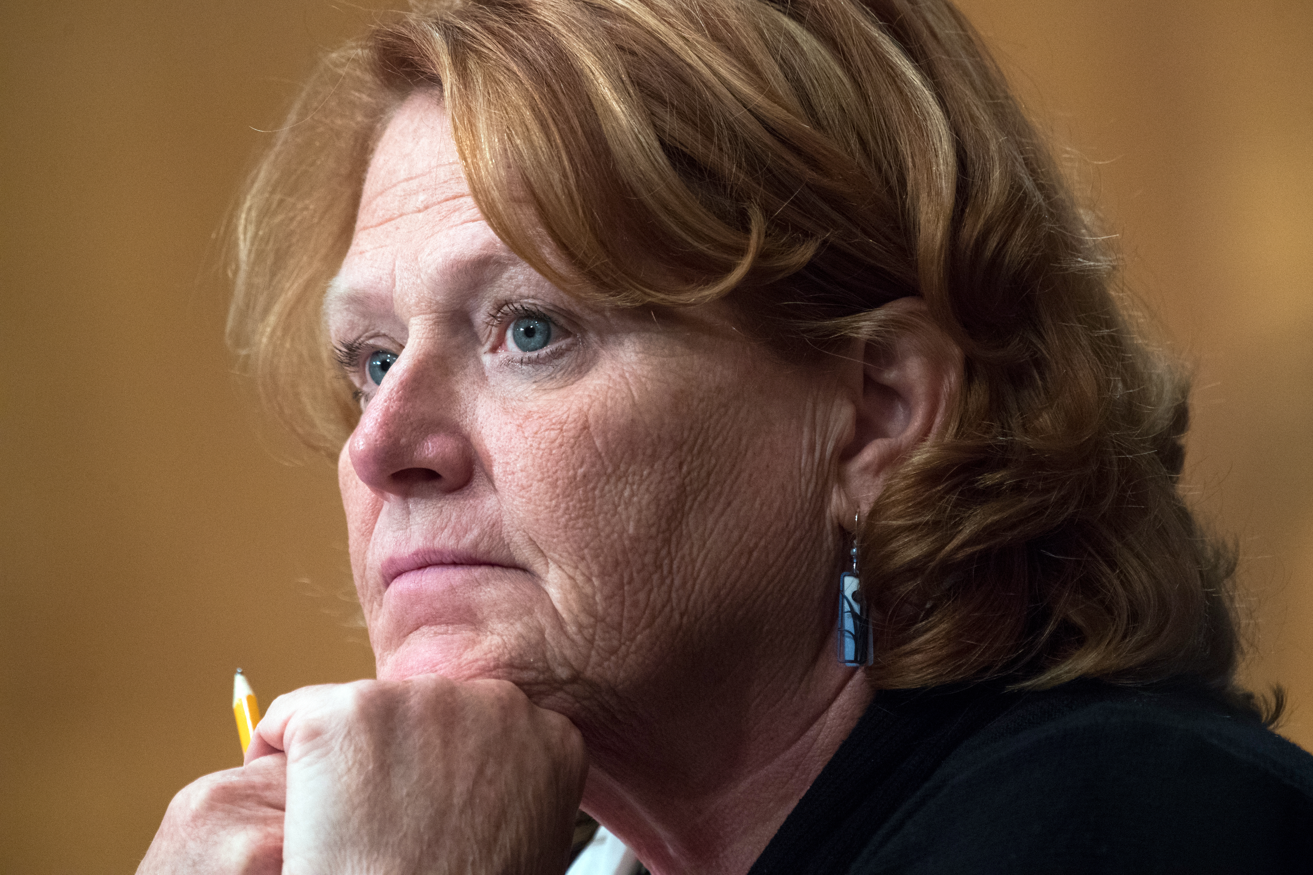 """UNITED STATES - OCTOBER 2: Sen. Heidi Heitkamp, D-N.D., attends a Senate Banking Committee hearing in Dirksen Building titled """"Implementation of the Economic Growth, Regulatory Relief, and Consumer Protection Act,"""" on October 2, 2018. (Photo By Tom Williams/CQ Roll Call)"""