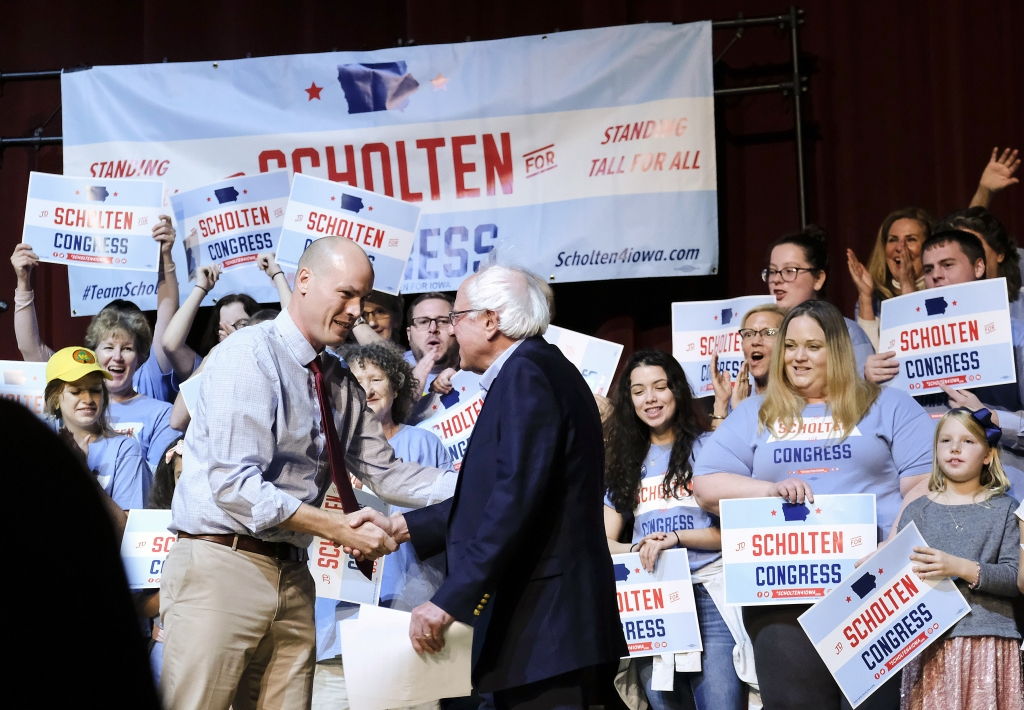 October 20, 2018 - Sioux City, IOWA, USA - U.S. Sen. BERNIE SANDERS (I-VT) greets Iowa's 4th Congressional District Democratic candidate J.D. SCHOLTEN before speaking about the upcoming midterm elections as he campaigns for Scholten at the Morningside College's Eppley Auditorium in Sioux City, Iowa Saturday, Oct. 20 2018. Scholten is running against Iowa's Congressman Steve King. (Credit Image: © Jerry Mennenga/ZUMA Wire)