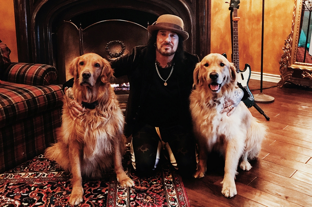 Nikki Sixx at home with his two dogs.