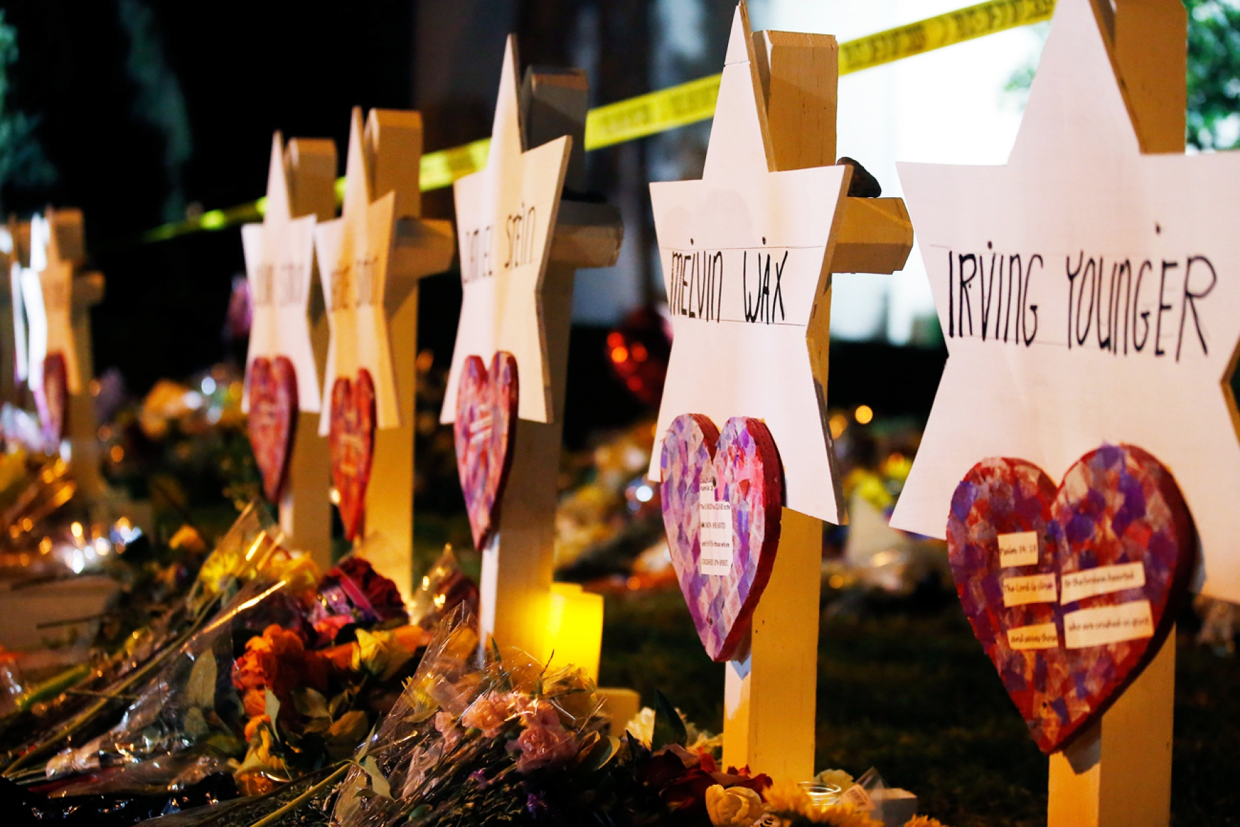The Star of David memorials are lined with flowers at the Tree of Life synagogue two days after a mass shooting in Pittsburgh