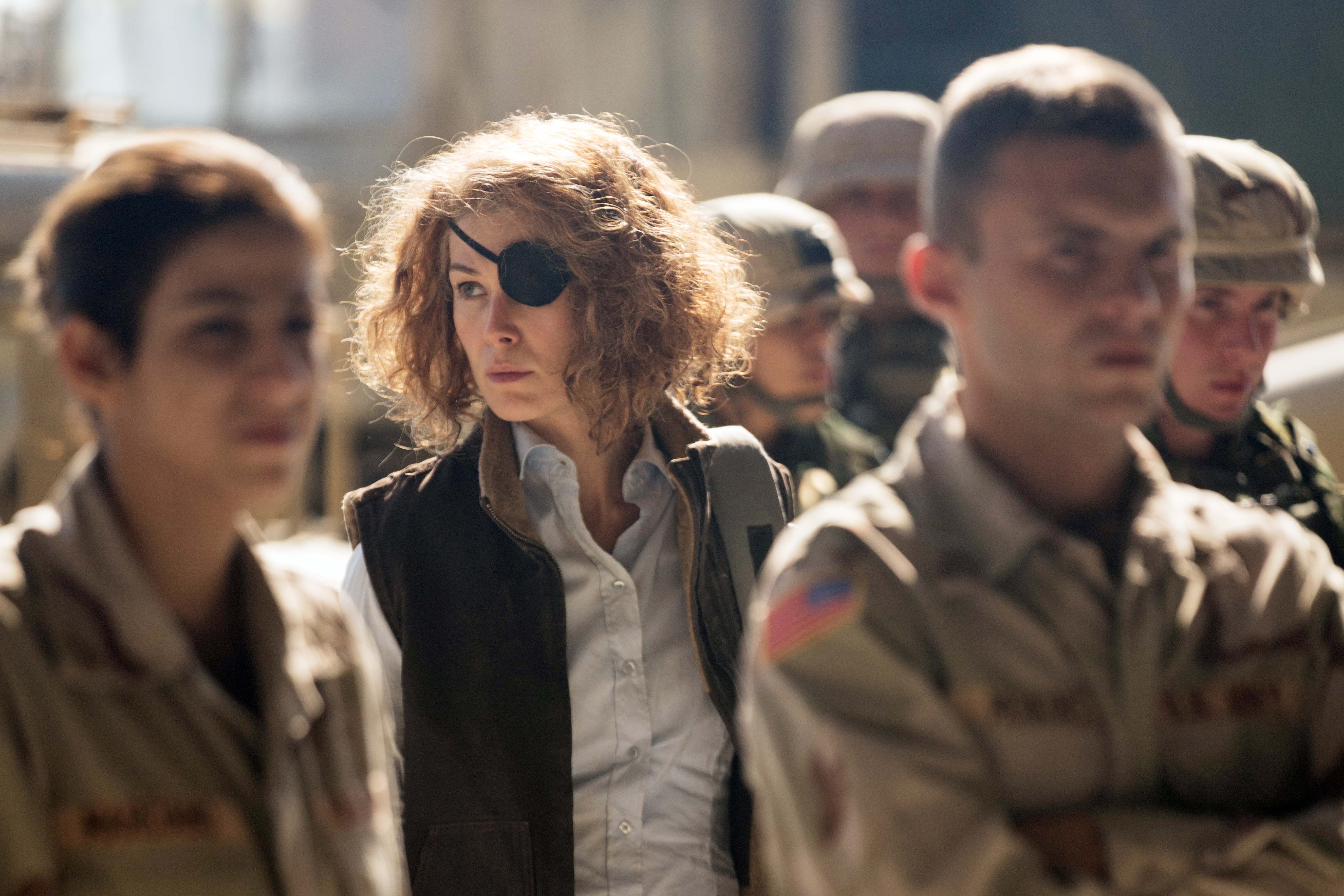 Marie Colvin (Rosamund Pike) enters the U.S. military base in the Iraqi Green Zone in A PRIVATE WAR.
