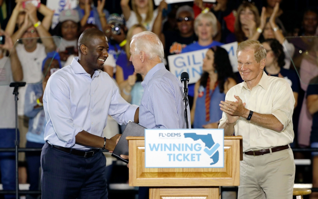 Former Vice President Joe Biden, center, meets Florida Democratic gubernatorial candidate Andrew Gillum, left, and U.S. Sen. Bill Nelson, D-Fla., during a campaign rally for Gillum and Nelson., at the University of South Florida in Tampa, FlaBiden Florida, Tampa, USA - 22 Oct 2018