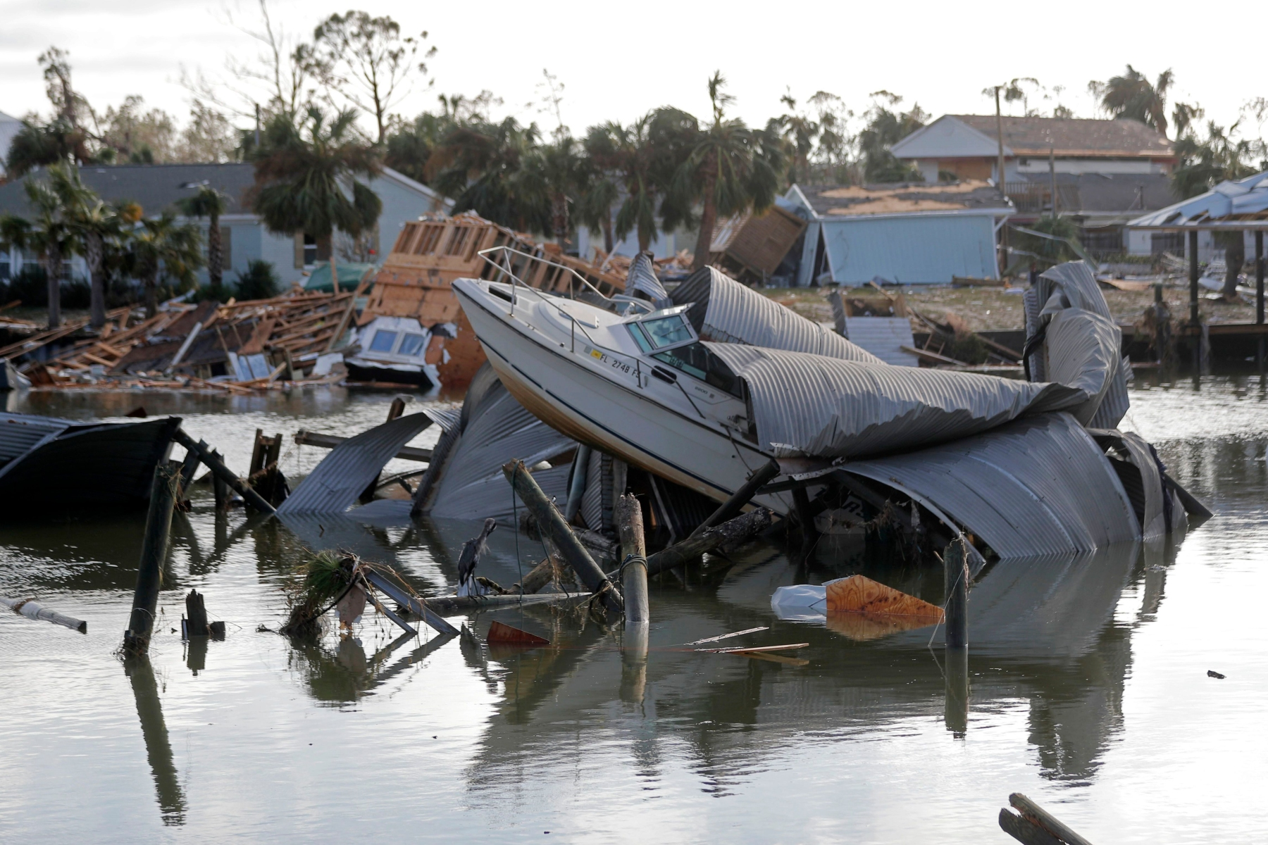 A boat sits amidst debris in the aftermath of Hurricane Michael in Mexico Beach, FlaTropical Weather, Mexico Beach, USA - 11 Oct 2018