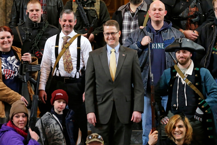 Matt Shea Washington Rep. Matt Shea, R-Spokane Valley, center, poses for a group photo with gun owners, inside the Capitol in Olympia, Wash., following a gun-rights rally opposing the state's Initiative 594, which requires - with only a few exceptions - background checks on all gun sales and transfersGun Protest, Olympia, USA