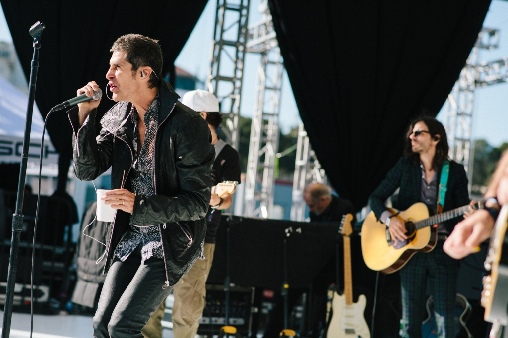 Perry Farrell warms up with a warm beverage during soundcheck.