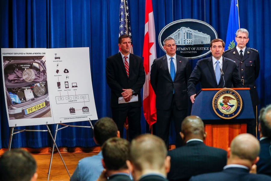 John Demers (2-R), assistant attorney general for the US Department of Justice National Security Division, announces criminal charges against seven Russian Federation GRU intelligence officers in Washington, DC, USA, 04 October 2018. The group, which includes several agents recently arrested at The Hague, are charged with hacking individuals and organizations in the United States, Canada and Europe. Those organizations include several anti-doping agencies, chemical weapons enforcement, and Westinghouse, according to the indictment.Seven Russian intelligence officers charged with hacking conspiracy., Washington, USA - 04 Oct 2018