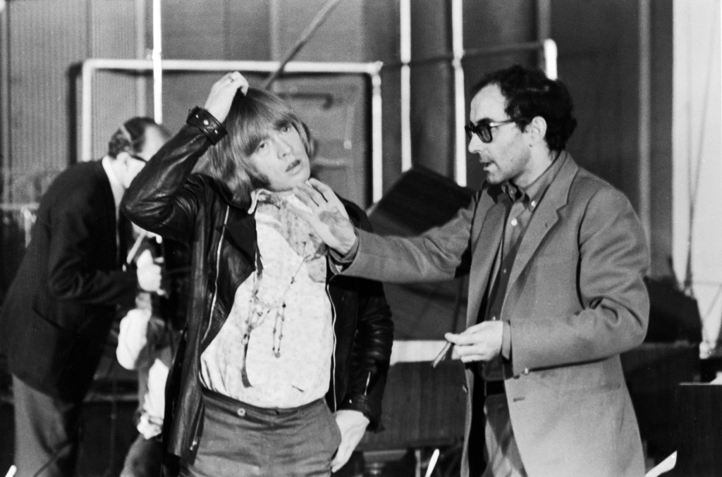 Jean-Luc Godard (right) directs Brian Jones (1942 - 1969) of the Rolling Stones during the shooting of the documentary film 'Sympathy For the Devil' (aka 'One Plus One'), 30th July 1968. (Photo by Keystone Features/Hulton Archive/Getty Images)
