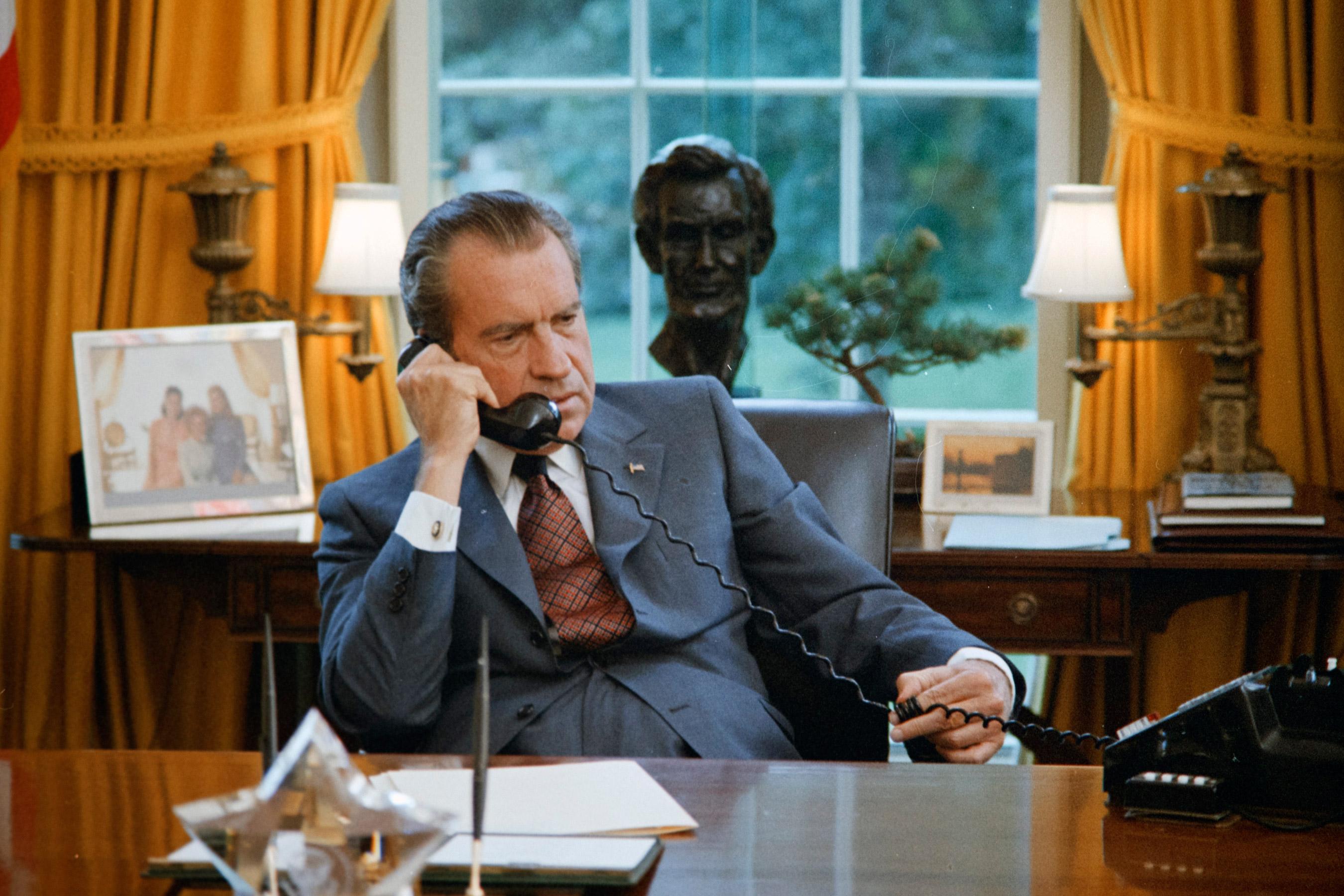 President Nixon seated at his desk, June 23, 1972.