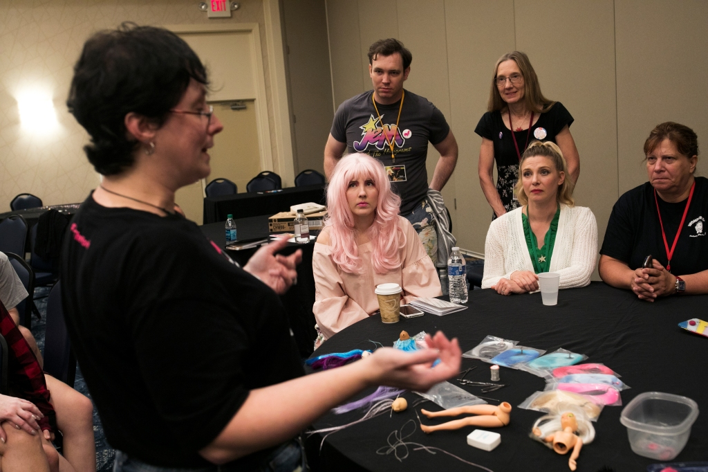 People listen to a demonstration on styling doll hair at JemCon on August 26, 2018 in Westlake, OH. JemCon is a convention for fans of a popular 1980s cartoon show about a female rockstar and her business woman alter ego.