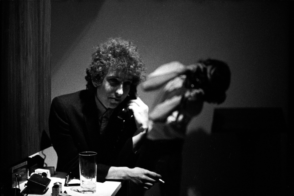 "On a freezing cold day in the winter of 1966, photographer Jerry Schatzberg and Bob Dylan drove over to the far West Side of Manhattan to shoot some photos for the cover of his new album Blonde on Blonde. They wound up near a brick building right off the West Side Highway and shot for about 30 minutes until Schatzberg's hand's were shivering and creating blurry images. ""We shot a lot of sharp ones that day,"" says Schatzberg. ""I was delighted he picked a blurry one for the cover. If I had made the final choice I don't think I would have sent it because I didn't think the record company was that clever."" The Blonde on Blonde cover is the most famous Dylan photo that Schatzberg shot, but it was just one of many brilliant images he created throughout the course of their friendship. Daniel Kramer, Don Hunstein and Elliott Landy have received significantly more recognition than Schatzberg for their images of Dylan in the Sixties, but that's finally starting to change with the release of Schatzberg's new photo book Dylan by Schatzberg. It reveals that his work with Dylan goes way beyond the Blonde on Blonde cover, covering everything from the Highway 61 Revisited recording sessions to his earliest electric concerts with future members of the Band. We spoke with Schatzberg (who remains incredibly sharp and lucid at age 91) about 14 incredible photos from the book."
